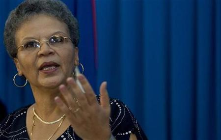 Michele Pierre-Louis, speaks to the media during her first news conference as Haitian prime minister, in Port-au-Prince